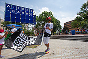 Wilkes-Barre, PA (July 11, 2020) -- A woman waves a Black Lives Matter flag on Public Square during the Black Lives Matter NEPA United Movement event in Wilkes-Barre.