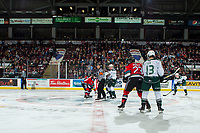 KELOWNA, BC - SEPTEMBER 28:  Referee Matt Hicketts stands at center ice between Kyle Crosbie #18 of the Kelowna Rockets and Reece Vitelli #26 of the Everett Silvertips at Prospera Place on September 28, 2019 in Kelowna, Canada. (Photo by Marissa Baecker/Shoot the Breeze)