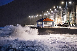 © London News Pictures. 23/02/2017. Aberystwyth,UK. In the early hours of Thursday morning, Storm Doris, the fourth named storm of the winter, hits the seaside town of Aberystwyth, bringing massive waves pounding against the promenade and sea defences. Violent Storm Force 11 winds, with gusts of  of up to 90mph are forecast for part of North Wales and NorthWest England, with the risk of damage to property and severe disruption t travel<br /> Photo credit: Keith Morris/LNP