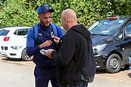 AFC Wimbledon defender Nesta Guinness-Walker (18) arriving and signing autographs during the EFL Sky Bet League 1 match between AFC Wimbledon and Accrington Stanley at the Cherry Red Records Stadium, Kingston, England on 17 August 2019.