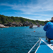 Man on the boat at diving spot near Similan islands in Thailand
