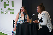 """Reporter Lindsay Christians laughs with guest Nyanyika Banda during the """"Corner Table Podcast"""" recording at Old Sugar Distillery in Madison, Wisconsin, Tuesday, June 18, 2019."""