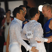 Rainer Dietzel, right, and Thomas Bensch, second from left, both of Germany, greet their competitors after dancing in the men's senior latin division of the same-sex ballroom dancing competition during the 2007 Eurogames at the Waagnatie hangar in Antwerp, Belgium on July 13, 2007. ..Over 3,000 LGBT athletes competed in 11 sports, including same-sex dance, during the 11th annual European gay sporting event. Same-sex ballroom is a growing sports that has been happening in Europe for over two decades.