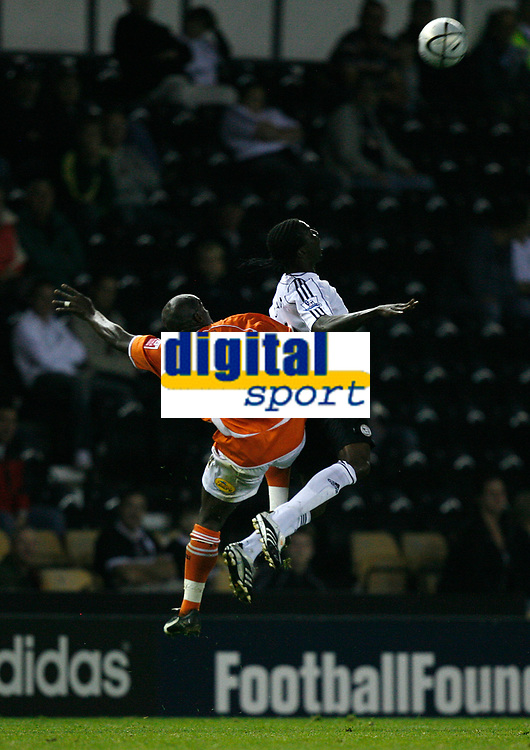 Photo: Steve Bond.<br />Derby County v Blackpool. Carling Cup. 28/08/2007. Mo Camera (R) defends as Adrian Forbes climbs (L)