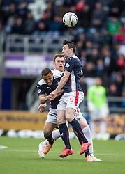 Falkirk's Tom Taiwo, Hibernian's Liam Craig and Falkirk's David Smith. <br /> Falkirk 0 v 3 Hibernian, Scottish Championship game played at The Falkirk Stadium 2/5/2015.