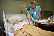 """Joan Wortman talks with her patient Bettyann Hook, of Chelsea, Vt. who was also a farmer, at Gifford Medical Center in Randolph, Monday, May, 2, 2016. """"I went into nursing to get away from cows and the bookwork,"""" said Joan, who formerly worked as an RN at the VA hospital in White River Junction, Vt. """"(Dairy farming) is 25 hours a day, eight days a week, and I'm thinking, I don't think I want this, so I went to nursing school."""" (Valley News - James M. Patterson) Copyright Valley News. May not be reprinted or used online without permission. Send requests to permission@vnews.com."""