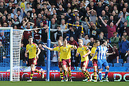 Burnley defender Stephen Ward (23) celebrates but the chance is ruled out as ball did not cross the line during the Sky Bet Championship match between Brighton and Hove Albion and Burnley at the American Express Community Stadium, Brighton and Hove, England on 2 April 2016.