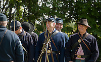 Tom Dodge of the 5th NH Regiment Volunteers shares a laugh with his comrades as they line up for the Sanbornton Old Home Day parade Saturday.  (Karen Bobotas/for the Laconia Daily Sun)