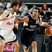 Fenerbahce's Omer ONAN (L) and Efes Pilsen's Kerem TUNCERI (R) during their Turkish Basketball Legague Play-Off semi final first match Fenerbahce between Efes Pilsen at the Sinan Erdem Arena in Istanbul Turkey on Tuesday 24 May 2011. Photo by TURKPIX