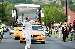 from the Chapeltown - Ecclesfield - Parson Cross section of the Journey.<br /> Locals take advantage of every possible vantage point as <br /> Torch bearer 110 Mark Bennehan continues the torches journey up Yew Lane, out of Ecclesfield and on towards Parson Cross<br /> 25 June 2012.<br /> Image © Paul David Drabble