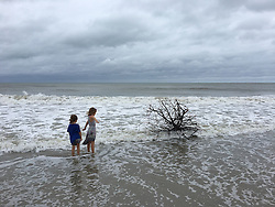 October 7, 2016 - Jupiter, Florida, U.S. - FELICITY COCHRAN, 7, and her sister TESSA, 6, of Jupiter, check out the beach in Jupiter south of Carlin Park on Friday morning. (Credit Image: © Richard Graulich/The Palm Beach Post via ZUMA Wire)