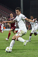 Gabriel Muresan (L) of CFR Cluj challenges Robin van Persie (R) of Manchester United during the UEFA Champions League, Group H, soccer match at Dr. Constantin Radulescu Stadium in Cluj-Napoca, Romania, 2 October 2012.