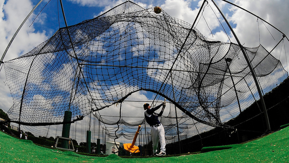 A Fullerton Hornets baseball player hits a ball into a practice net in preparation for his home game Thursday at Fullerton College in  Fullerton, CA.