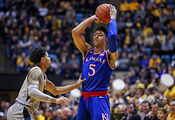 Jan 19, 2019; Morgantown, WV, USA; Kansas Jayhawks guard Quentin Grimes (5) attempts to pass the ball during the first half against the West Virginia Mountaineers at WVU Coliseum. Mandatory Credit: Ben Queen-USA TODAY Sports