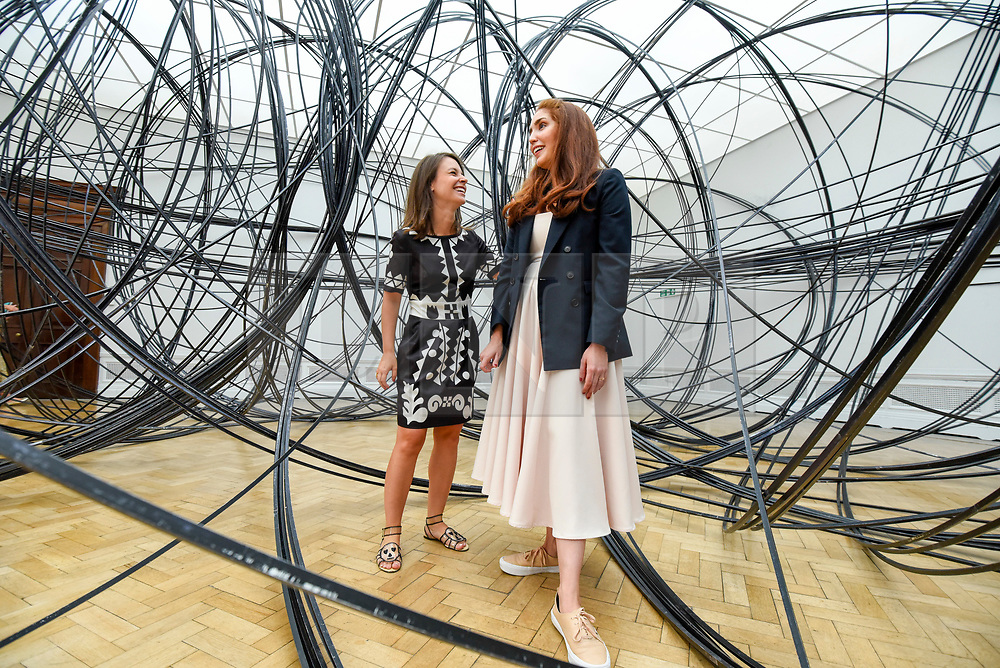 """© Licensed to London News Pictures. 17/09/2019. LONDON, UK. Visitors experience """"Clearing VII"""", 2019, by Antony Gormley, 8km of aluminium tubing. Preview of a new exhibition by Antony Gormley at the Royal Academy of Arts.  The show bring together existing and specially conceived new works from drawing to sculptures to experimental environments to be displayed in all 13 rooms of the RA's Main Galleries 21 September to 3 December 2019.  Photo credit: Stephen Chung/LNP"""