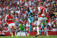Diafra Sakho of West Ham United takes a shot at goal. Barclays Premier League, Arsenal v West Ham Utd at the Emirates Stadium in London on Sunday 9th August 2015.<br /> pic by John Patrick Fletcher, Andrew Orchard sports photography.