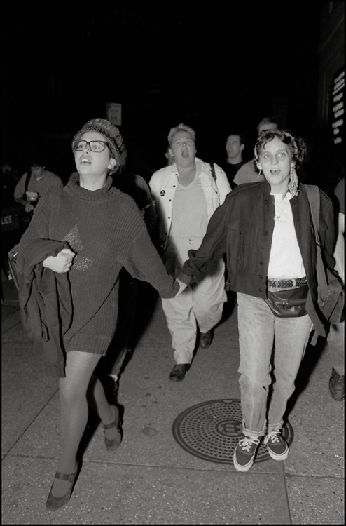 At a Monday night ACT UP meeting in September 1989, it was brought to the floor that a gay man had been kicked out of the ER at St. Vincents Hospital by a security guard because he had dared to kiss his lover. A heated conversation ensued and eventually the whole room got up, walked around the corner to the hospital and took over the waiting room in the ER. As a result, the hospital agreed to meet with representatives of ACT UP. <br /> <br /> Several ACT UP members met with the president of the hospital and the executive board, which resulted in sensitivity training for all of their employees.<br /> <br /> Gerri Wells, Garance Franke-Ruta and others on their way from The Center to St. Vincents Hospital.