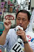 "Hiroshi Yamada of The Spirit of Japan (Nippon Soshinto) which is right Wing/Nationalist) political party with ties to the  Shinzo Abe-led bipartisan group of lawmakers, ""Sosei-Nippon,"" and the Sunrise Party of Japan, led by Takeo Hiranuma, campaigning in Tokyo, Japan, Friday July 9th 2010"