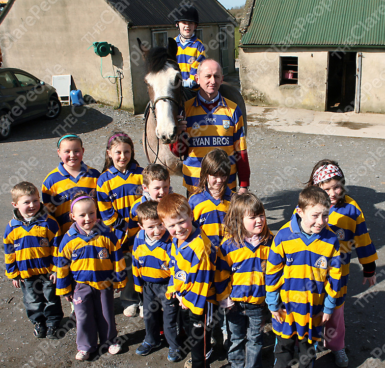 Cyril Lyons with Pagraig Casey on Paddy and other pupils from Scoil Mhuire in Ruan getting ready for their race night in Murty Kelly's Bar on May 2nd for the schools extension.<br /> Photograph by Yvonne Vaughan