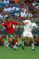 Lisbon 16/6/2004 Euro2004 <br />RUSSIA PORTUGAL<br />Maniche and Alenitchev<br />Photo Graffiti