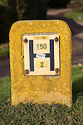 Close up of yellow water hydrant sign, UK