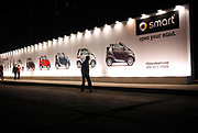 Visitors walk past a smart advertisement during the smart for two China Launch in Shanghai, China on 08 April 2009. China's automobile market saw a rapid growth in the past decade and it is now the biggest automobile market in the world, the title has come with a price however, with many cities roads clogged, some local governments are issuing new directives limiting new vehicle purchases.