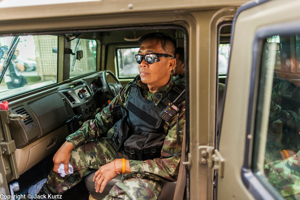"""20 MAY 2104 - BANGKOK, THAILAND:  A Thai army officer in a humvee type vehicle after the declaration of martial law. The Thai Army declared martial law throughout Thailand in response to growing political tensions between anti-government protests led by Suthep Thaugsuban and pro-government protests led by the """"Red Shirts"""" who support ousted Prime Minister Yingluck Shinawatra. Despite the declaration of martial law, daily life went on in Bangkok in a normal fashion. There were small isolated protests against martial law, which some Thais called a coup, but there was no violence.  PHOTO BY JACK KURTZ"""