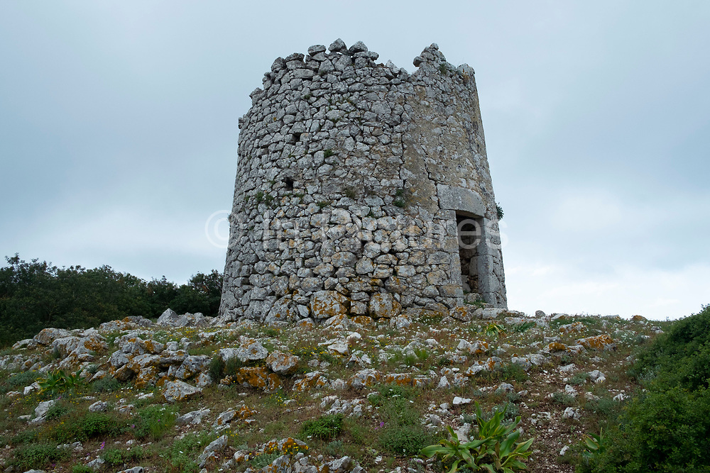 Ruins of ancient windmills around Exogi, Ithaca, Greece. Ithaca, Ithaki or Ithaka is a Greek island located in the Ionian Sea to the west of continental Greece. Ithacas main island has an area of 96 square kilometres. It is the second-smallest of seven main Ionian Islands.