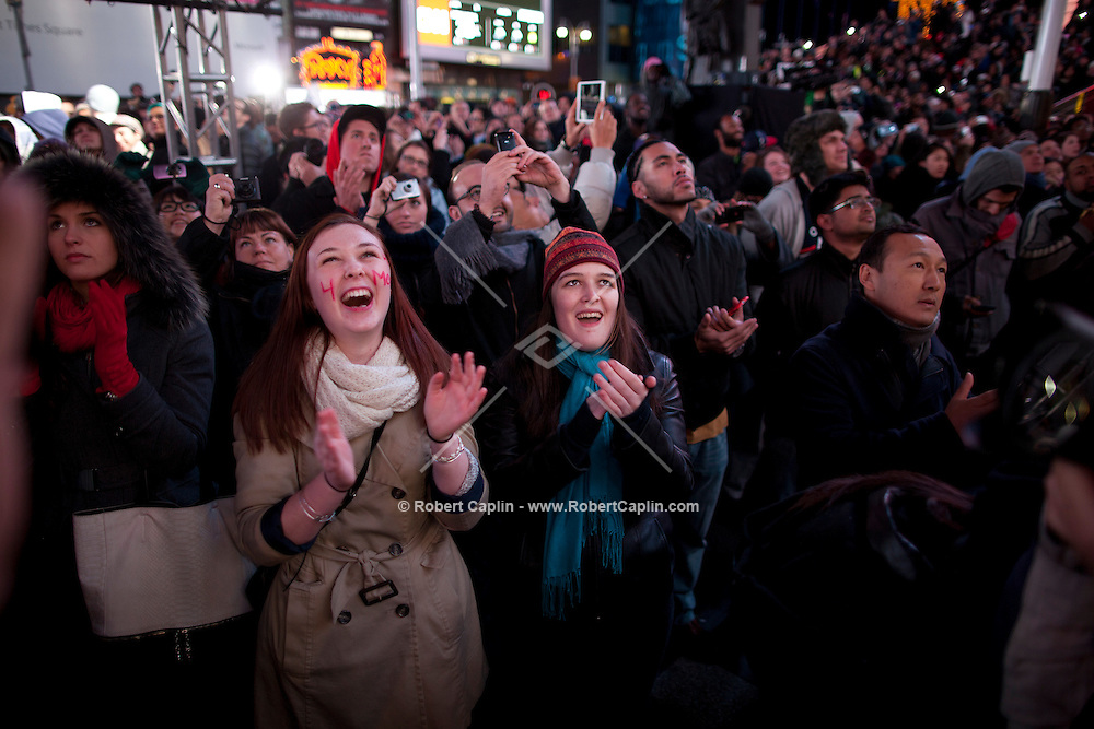 Mara McGuinness, left, and Fiona Murray, right, celebrate in Times Square on election night. President Barack Obama defeated Mitt Romney to win the 2012 Presidential Election.  ..Photo by Robert Caplin.......