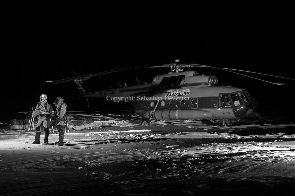 Mike Horn(Left)  & Borge Ousland  at Cape Articheski, North Siberia.  They left at 09:00 GMT 20.01.2006 for the North Pole, a distance of 1000 kms. If they get there before 21st March (sunrise at the North Pole) they will be the first to do it in winter. Cap Artichevsky is notorious for being a difficult point to start due to strong currents moving the fast ice. The conditions at the start were particularly treacherous as the temperatures were unusually high (-2 C) making this ice unstable. Fortunately a westerly wind had pushed fast ice on the western side of Cap Artichevsky, creating a bridge between the mainland and multiyear ice.  It is now a race against time to reach the multiyear before conditions change. Considering the difficult terrain and the fully laden sleds, it may take them up to two weeks to cover the 100 kms between the Cape and the safe ice.To know more about Borge and Mike visit www.ousland.com & www.mikehorn.com.<br /> <br /> See more images go to <br /> www.devenish.ch/login  <br /> user: mikehorn   Password: archive<br />  <br /> Free press pictures do the same but put in password: press<br /> <br /> International Picture distribution contact http://www.dppi.net/