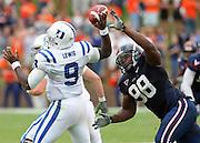 Virginia NT Nate Collins (98) puts pressure on Duke quarterback Thaddeus Lewis (9) during an ACC football game Saturday in Charlottesville, VA. Duke won 28-17. Photo/Andrew Shurtleff