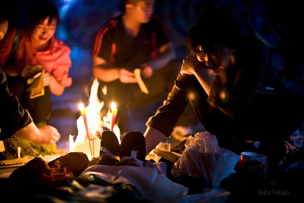 Family and friends grieve over their children, who were killed by collapse of  Juyuan Middle School caused by earthquake in Juyuan City, Dujiangyan county, Sichuan province in China.