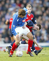 PORTSMOUTH 2 V SCUNTHORPE UNITED 1.     24.1.04. <br /> PORTSMOUTH'S PATRIK BERGER TUSSLES WITH SCUNTHORPE'S MATTHEW SPARROW IN THE F.A. CUP FOURTH ROUND MATCH AT FRATTON PARK.<br /> PIC BY HARRY HERD/SPORTSBEAT IMAGES