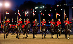 © London News Pictures. 10/05/2012. Windsor, UK. Cannadian Mounties performing on The opening night of the Diamond Jubilee Pageant in the private grounds of Windsor Castle, on May 10, 2012. 1200 performers and 600 horses from countries all around the world take part in the Pageant which runs for four nights celebrating 60 years on the throne for Queen Elizabeth II.  Photo credit: Ben Cawthra/LNP
