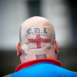 © Licensed to London News Pictures.  20/09/2014. LONDON, UK. A heavily tattooed member of the English Defence League (EDL) pictured during a march down Whitehall to Downing Street. The group is attempting to highlight it belief that  Muslim sexual grooming gangs are abusing English girls. Earlier this week a home office official warned of the rise of the far right. Photo credit: Cliff Hide/LNP