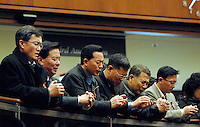 Members of the local Korean community in Fairfax, Virginia, pray together at a community vigil for those killed in the Virginia Tech shootings on April 16, 2007. Several of those killed, including the Korean shooter, were from Fairfax County.