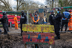 Bailiffs from the National Eviction Team (NET) use cherry pickers during a large security operation to dismantle a makeshift tower occupied by activists opposed to the HS2 high-speed rail link who were seeking to delay electricity pylon relocation works by Babcock in Denham Country Park on 22nd March 2021 in Denham, United Kingdom. Activists continue to oppose the controversial infrastructure project from a series of protest camps along its Phase 1 route between London and Birmingham.