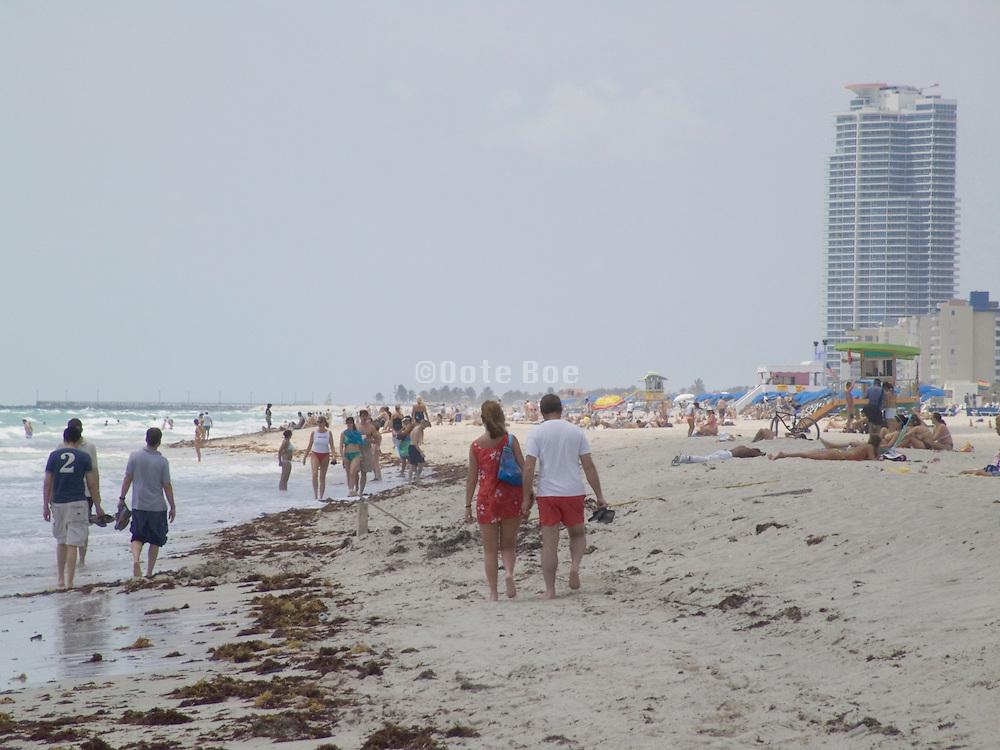 people walking along the beach Miami USA.
