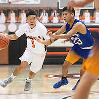 Gallup Bengal Quentin Richards (1) drives to the basket while guarded by Bloomfield Bobcat Mauricio Toledo (23) Friday night at Gallup High School in Gallup. The Bengals took the win 78-56.