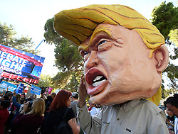 Oct. 19, 2016 - Las Vegas, Nevada, U.S. - TOM MORAN wears a large Trump head in the middle of the the rally at UNLV hours before the debate Wednesday. The third and final debate will be held Wednesday night at Las Vegas Nevada University. (Credit Image: © Gene Blevins via ZUMA Wire)