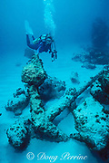 diver examines fluke of old double-ended anchor from <br /> circa 1840 wreck of English warship, <br /> Little Bahama Bank, near Walker's Cay, <br /> Bahamas ( Western Atlantic Ocean )  MR 89