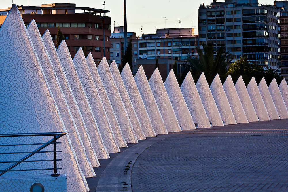 These architetural structures located near Palau de les Arts Reina Sofía, in Valencia, Spain are about 8-10 ft tall. With the telephoto from far away they look alot like a highway cone zone.