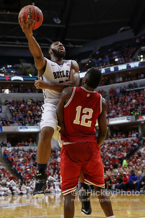 INDIANAPOLIS, IN - DECEMBER  20: Roosevelt Jones #21 of the Butler Bulldogs shoots the ball over Hanner Mosquera-Perea #12 of the Indiana Hoosiers at Bankers Life Fieldhouse on December 20, 2014 in Indianapolis, Indiana. Indiana defeated Butler 82-73. (Photo by Michael Hickey/Getty Images) *** Local Caption *** Roosevelt Jones; Hanner Mosquera-Perea