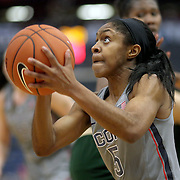 HARTFORD, CONNECTICUT- JANUARY 10: Crystal Dangerfield #5 of the Connecticut Huskies spins past Nancy Warioba #32 of the South Florida Bulls as she drives to the basket for two points during the the UConn Huskies Vs USF Bulls, NCAA Women's Basketball game on January 10th, 2017 at the XL Center, Hartford, Connecticut. (Photo by Tim Clayton/Corbis via Getty Images)