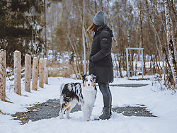 THEMENBILD - eine Frau mit ihrem Australian Shepherd in der winterlichen Landschaft, aufgenommen am 17. März 2021, Kaprun, Österreich // a woman with her Australian Shepherd in the wintry landscape, Kaprun, Austria on 2021/03/17. EXPA Pictures © 2021, PhotoCredit: EXPA/ JFK