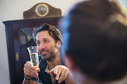 Man holding a glass of sparkling wine