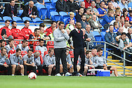 Cardiff city's caretaker coaches Scott Young and Danny Gabbidon ® look on. Skybet football league championship match, Cardiff city v Sheffield Wed at the Cardiff city stadium in Cardiff, South Wales on Saturday 27th Sept 2014<br /> pic by Andrew Orchard, Andrew Orchard sports photography.