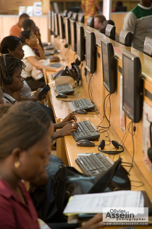 Customers browse the internet at the Busy Internet internet cafe in Accra, Ghana on Thursday February 1, 2007. Founded five years ago, the company offers the services of a standard internet cafe, but also provides internet access to 90,000 residential and commercial clients. Busy Internet has grown 30-35% since its creation, and has over 120 employees.