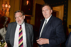 Left to right, JOHN RANDALL MP and GREG KNIGHT MP at a party to celebrate the publication of Strictly Ann by Ann Widdecombe held at the Carlton Club, 69 St.James's Street, London on 6th June 2013.