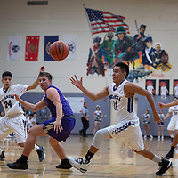 Noah Nells (11) chases down a loose ball against Kirtland Central Thursday night in Gallup.